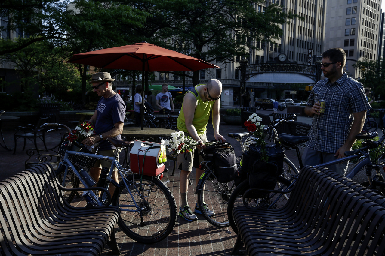Cyclists decorate their bikes with flowers at Bike Party Indianapolis in downtown Indianapolis on Friday, June 9, 2017. The cyclists could win prizes for the best decorated bike.