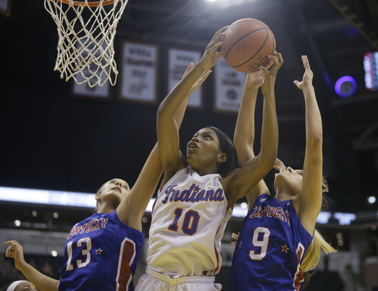 New Albany's Chyna Anthony (10), Metcalfe County's Mackenzie Coleman (13), and Franklin County's Rebecca Cook (9) at the Indiana vs. Kentucky High School All-Star game at Bankers Life Fieldhouse in Indianapolis on Saturday, June 10, 2017.