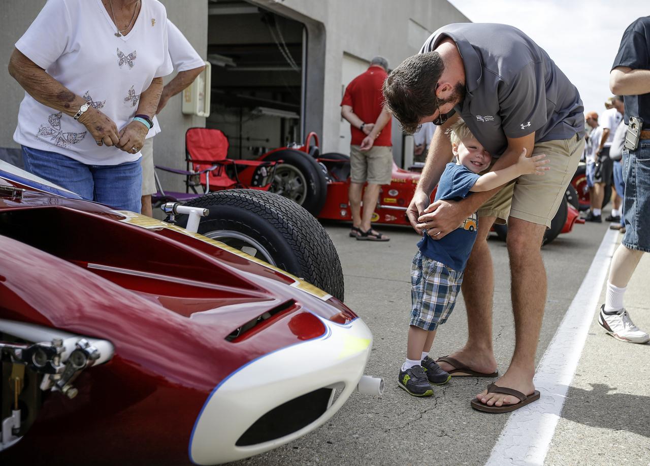 Elliott Marshall, 3, hugs his neighbor Too Belli at the SVRA Brickyard Vintage Race at Indianapolis Motor Speedway on Saturday, June 17, 2017.