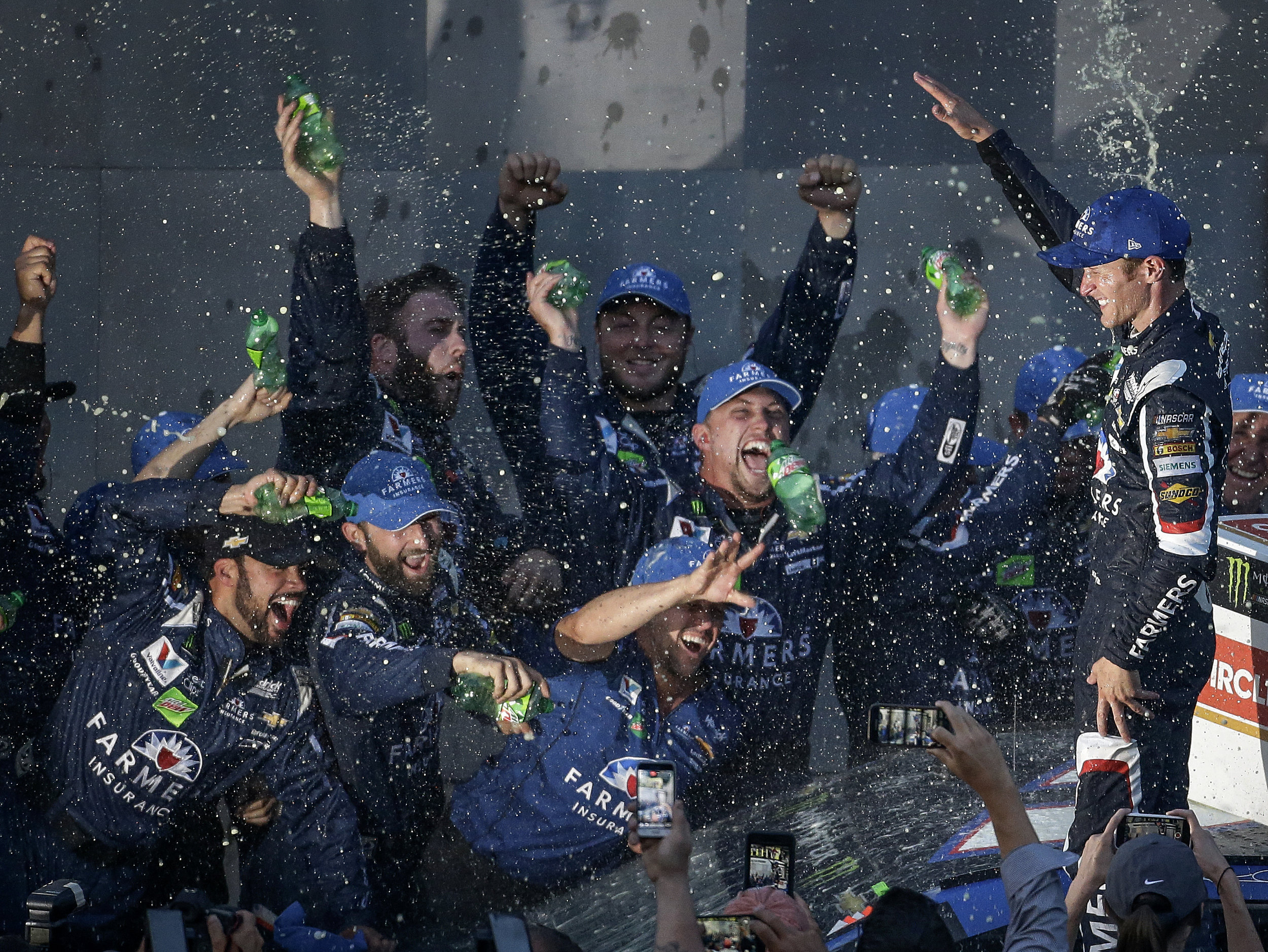 NASCAR driver Kasey Kahne and his crew celebrate their win at the Brickyard 400 at Indianapolis Motor Speedway on Sunday, July 23, 2017. The win came well-deserved after a race that involved a rain delay, a record-breaking 14 cautions, and 7 lead changes.