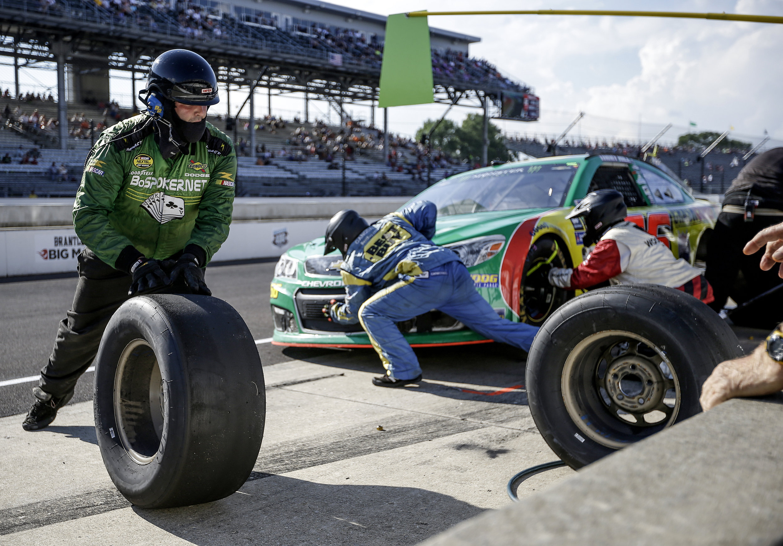 Monster Energy NASCAR Cup Series driver Carl Long's (66) pit crew quickly changes tires at Indianapolis Motor Speedway on Sunday, July 23, 2017.