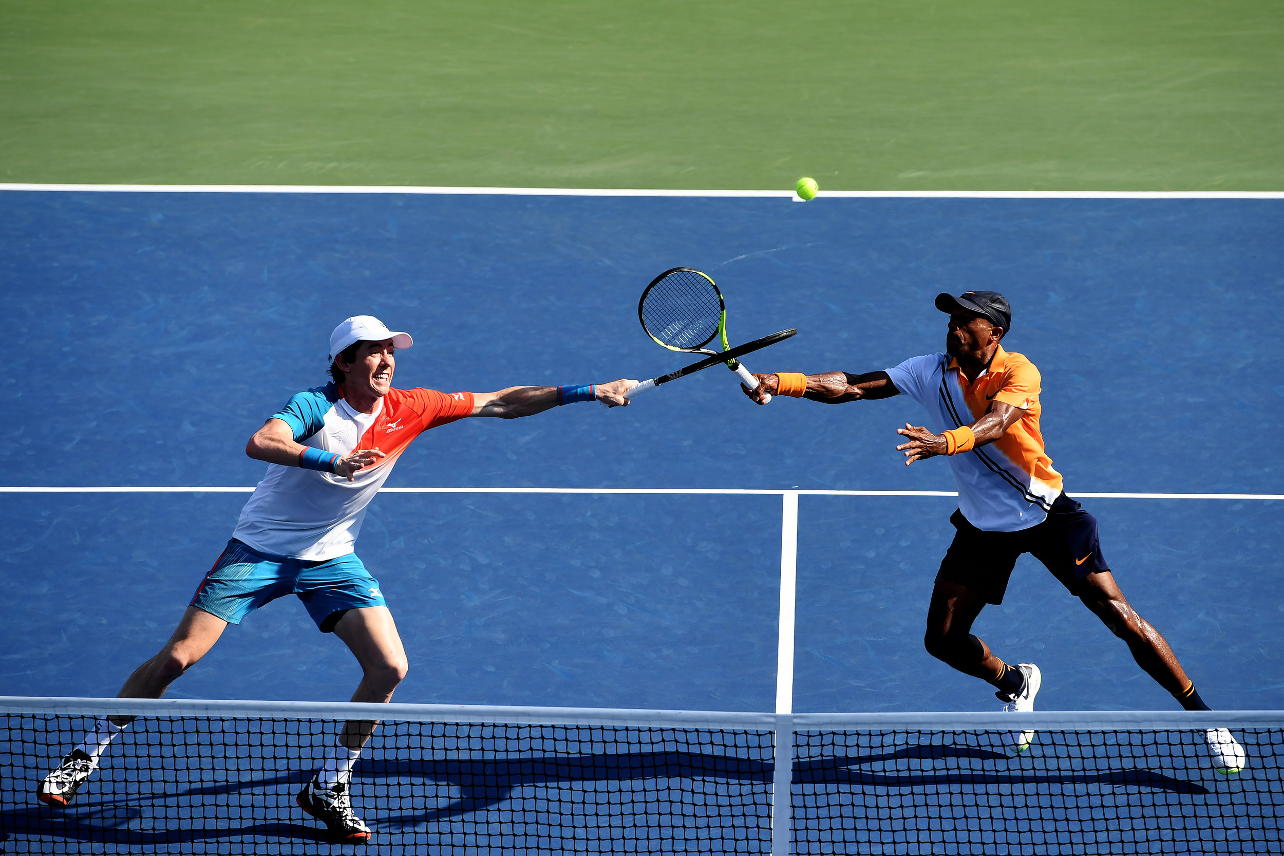 Nicholas Monro of the United States (R) and John-Patrick Smith of Australia in action during his men's doubles first round match against Nicolas Mahut and Pierre-Huhues Herbert of France on Day Three of the 2018 US Open at the USTA Billie Jean King National Tennis Center on August 29, 2018 in the Flushing neighborhood of the Queens borough of New York City.