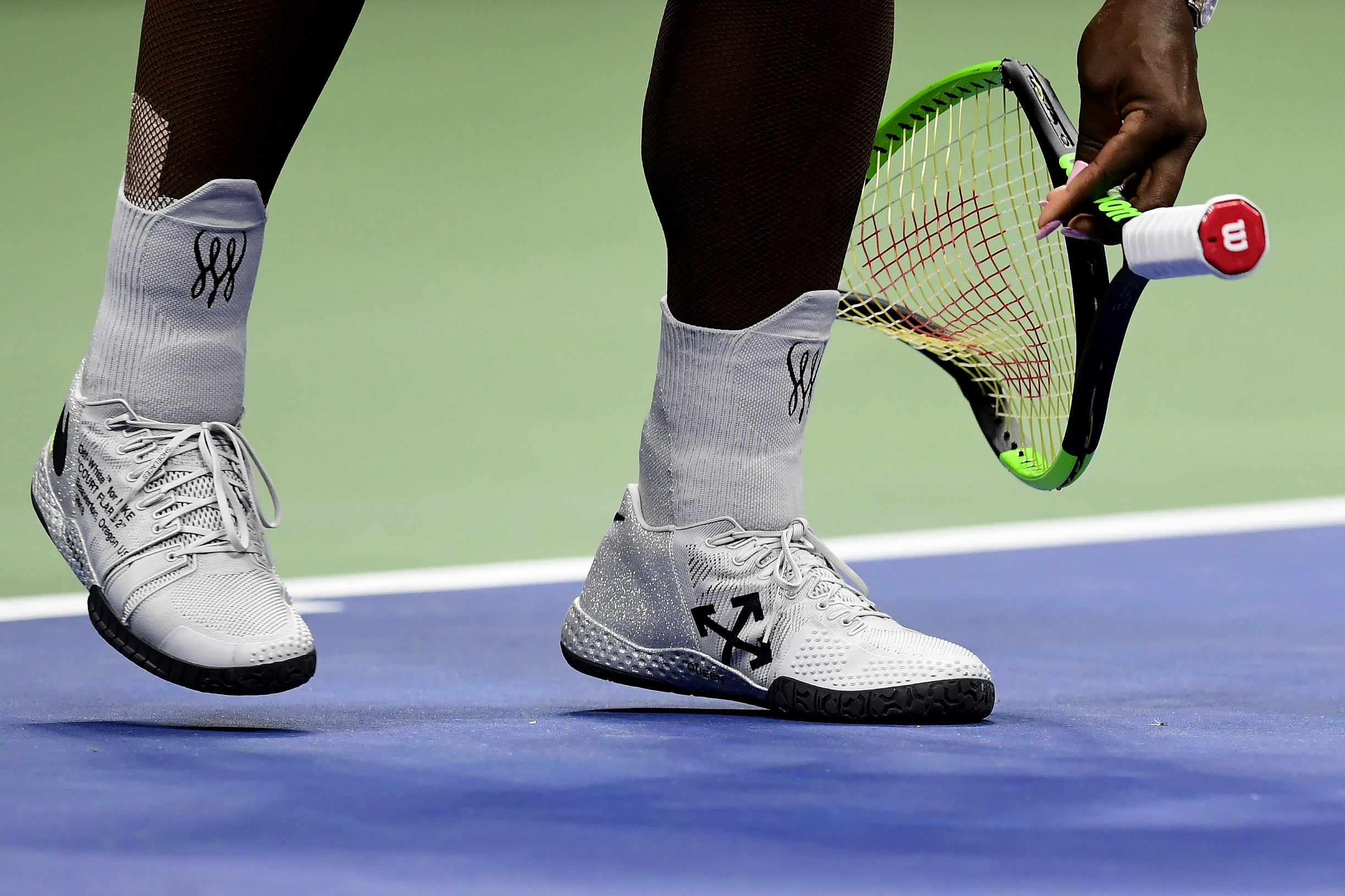 Serena Williams of the United States after smashing her racket during her Women's Singles finals match against Naomi Osaka of Japan on Day Thirteen of the 2018 US Open at the USTA Billie Jean King National Tennis Center on September 8, 2018 in the Flushing neighborhood of the Queens borough of New York City.