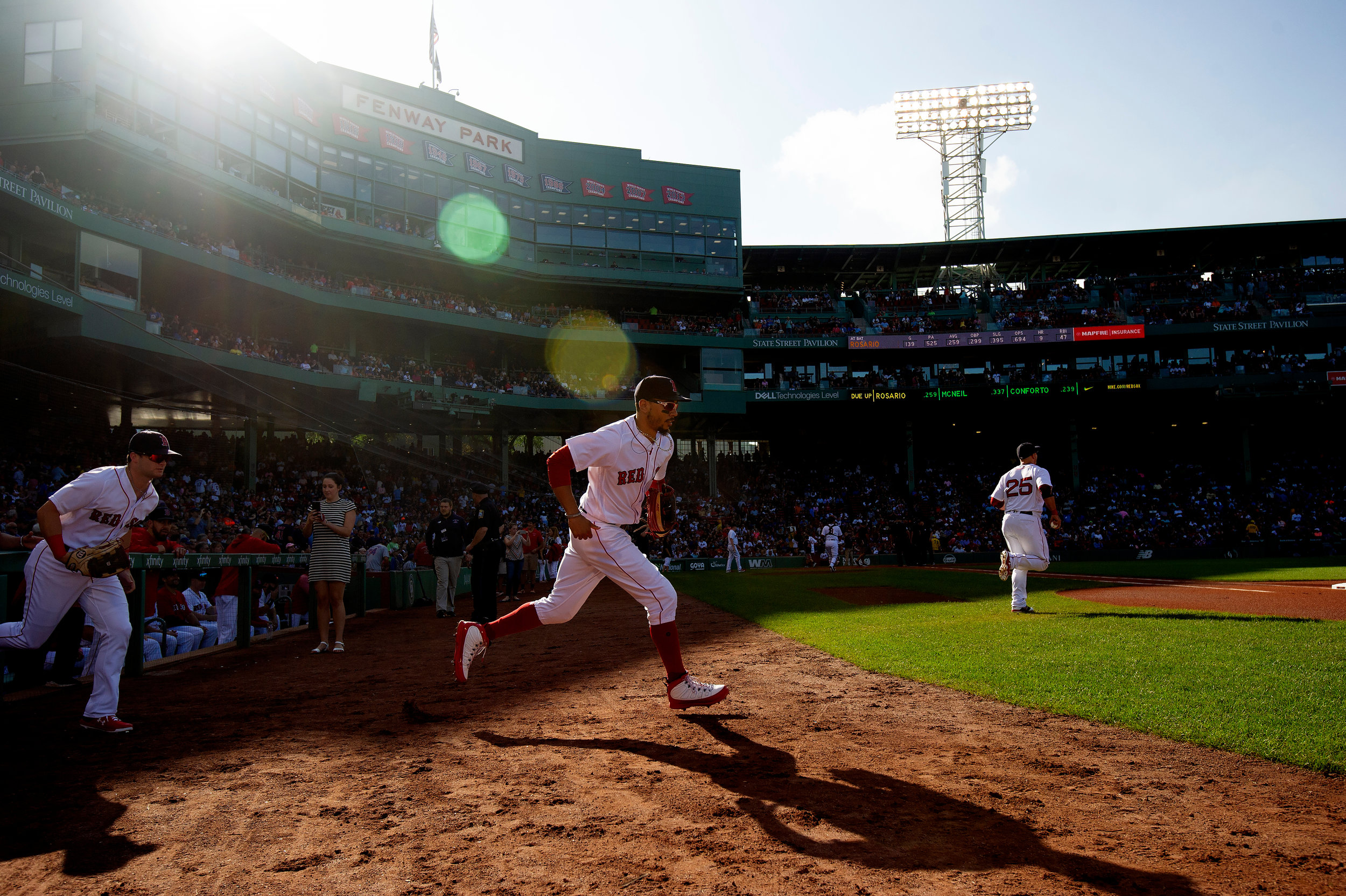 Boston Red Sox outfielder Mookie Betts runs onto the field at the start of the game against the New York Mets at Fenway Park in Boston, Massachusetts, on Saturday, September 15, 2018.