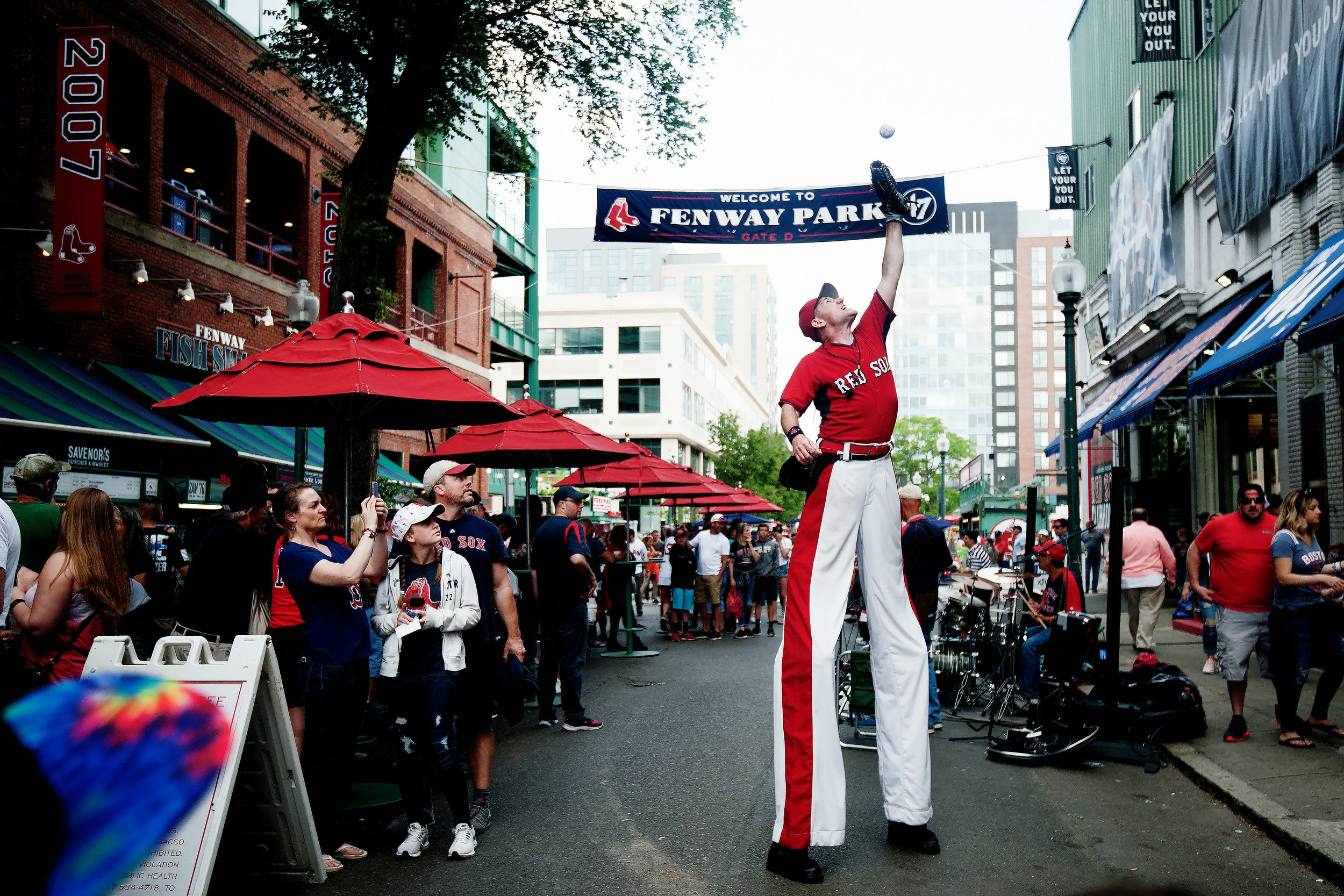 """Big League Brian"" entertains a crowd gathering on Jersey Street before the game against Chicago White Sox at Fenway Park in Boston, Massachusetts on Friday, June 8, 2018."