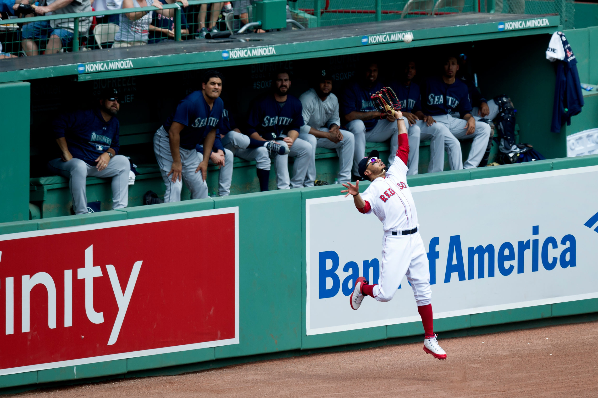 Boston Red Sox outfielder Mookie Betts makes a catch in the outfield during the game against the Seattle Mariners at Fenway Park in Boston, Massachusetts on Sunday, June 24, 2018.