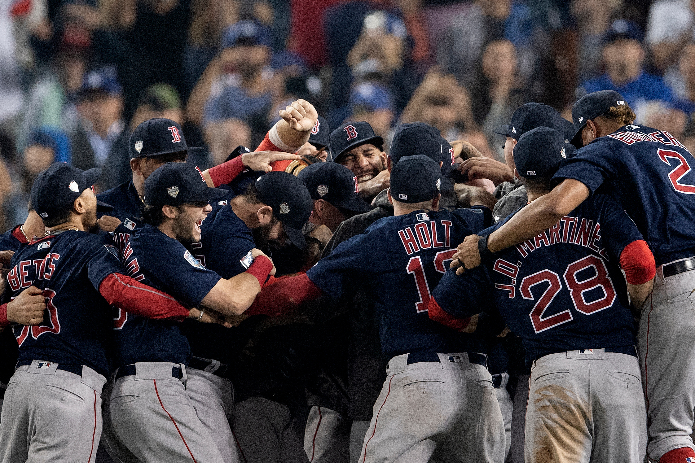 Members of the Boston Red Sox react after the final out was recorded to win the 2018 World Series in game five against the Los Angeles Dodgers at Dodger Stadium on Sunday, October 28, 2018.