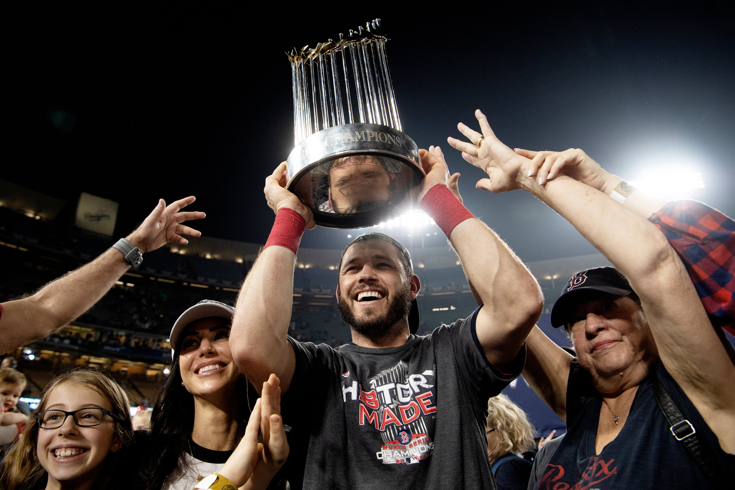 Boston Red Sox second baseman Ian Kinsler hoists the trophy over his head after winning Game 5 of the World Series versus Los Angeles Dodgers at Dodger Stadium on Sunday, October 28, 2018.