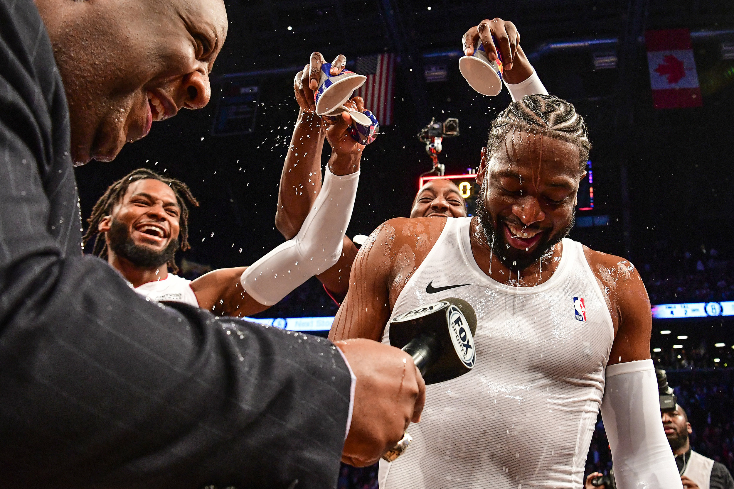 Teammates dump water on Dwyane Wade #3 of the Miami Heat after the game against the Brooklyn Nets at Barclays Center on April 10, 2019 in the Brooklyn borough of New York City. This was Wade's final game before retirement.