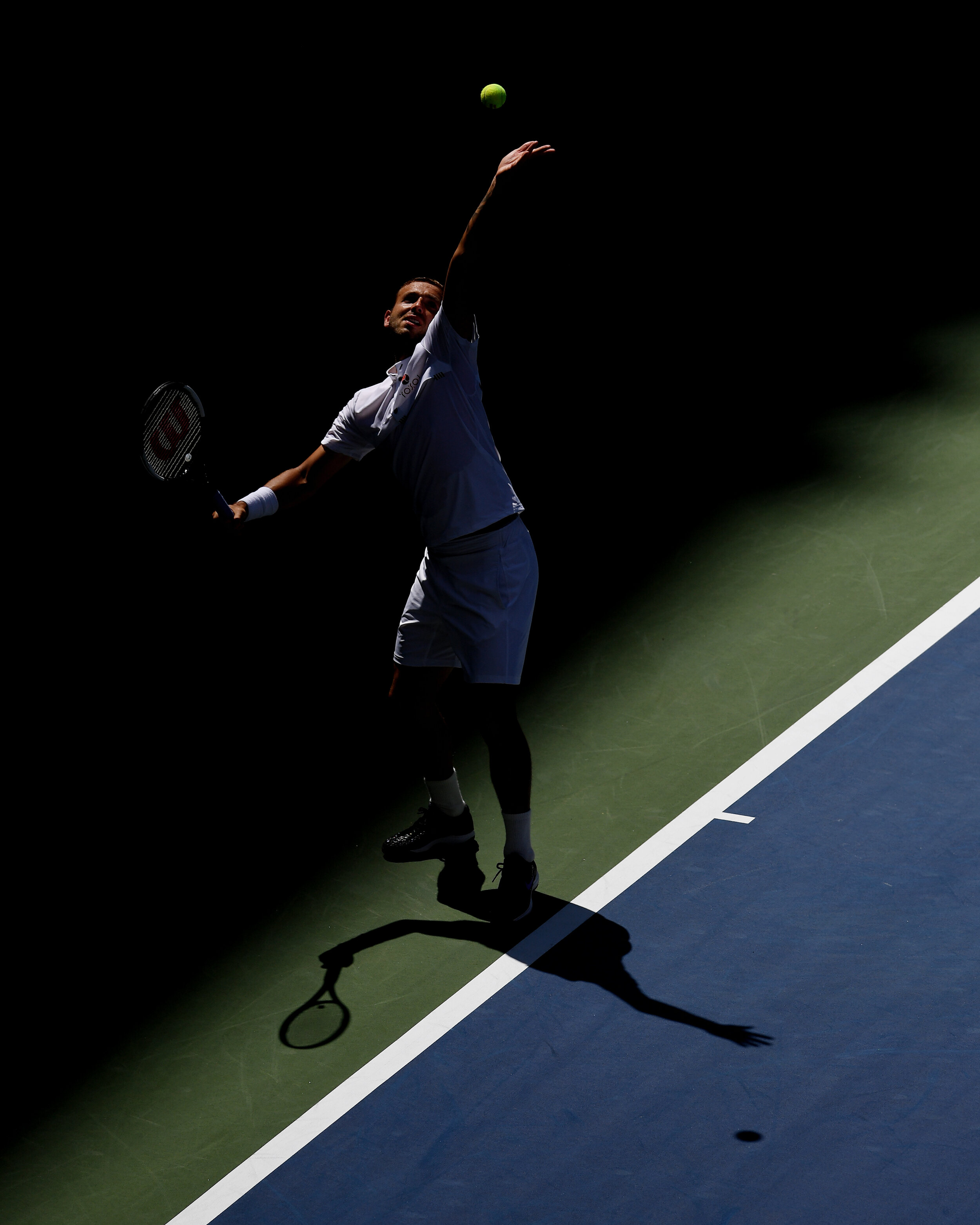 Daniel Evans, of the United Kingdom, serves to Roger Federer, of Switzerland, during round three of the US Open tennis championships Friday, Aug. 30, 2019, in New York.