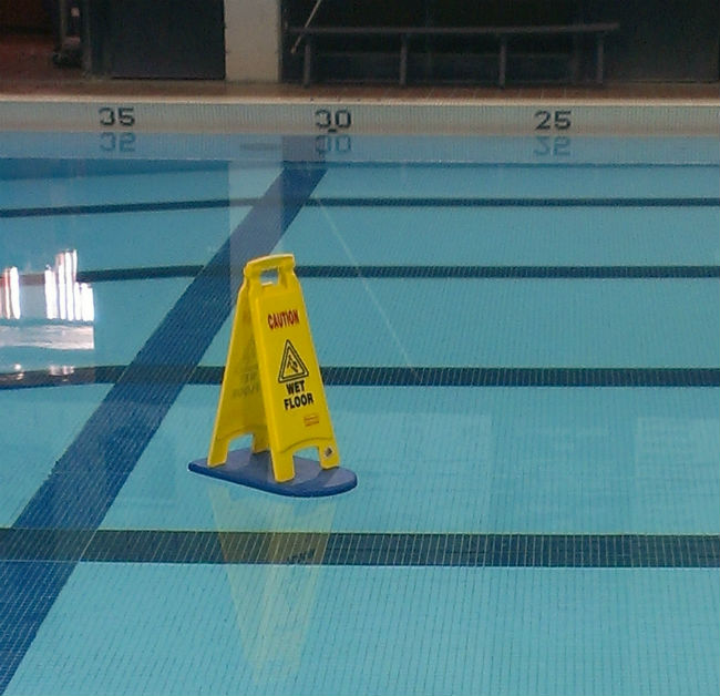 caution-wet-floor-in-the-pool.jpg