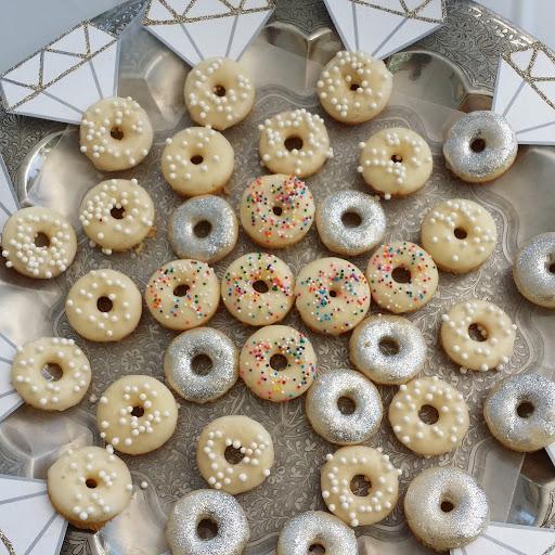 Mini Vanilla Bean Doughnuts with Lemon Glaze and Edible Sparkles!