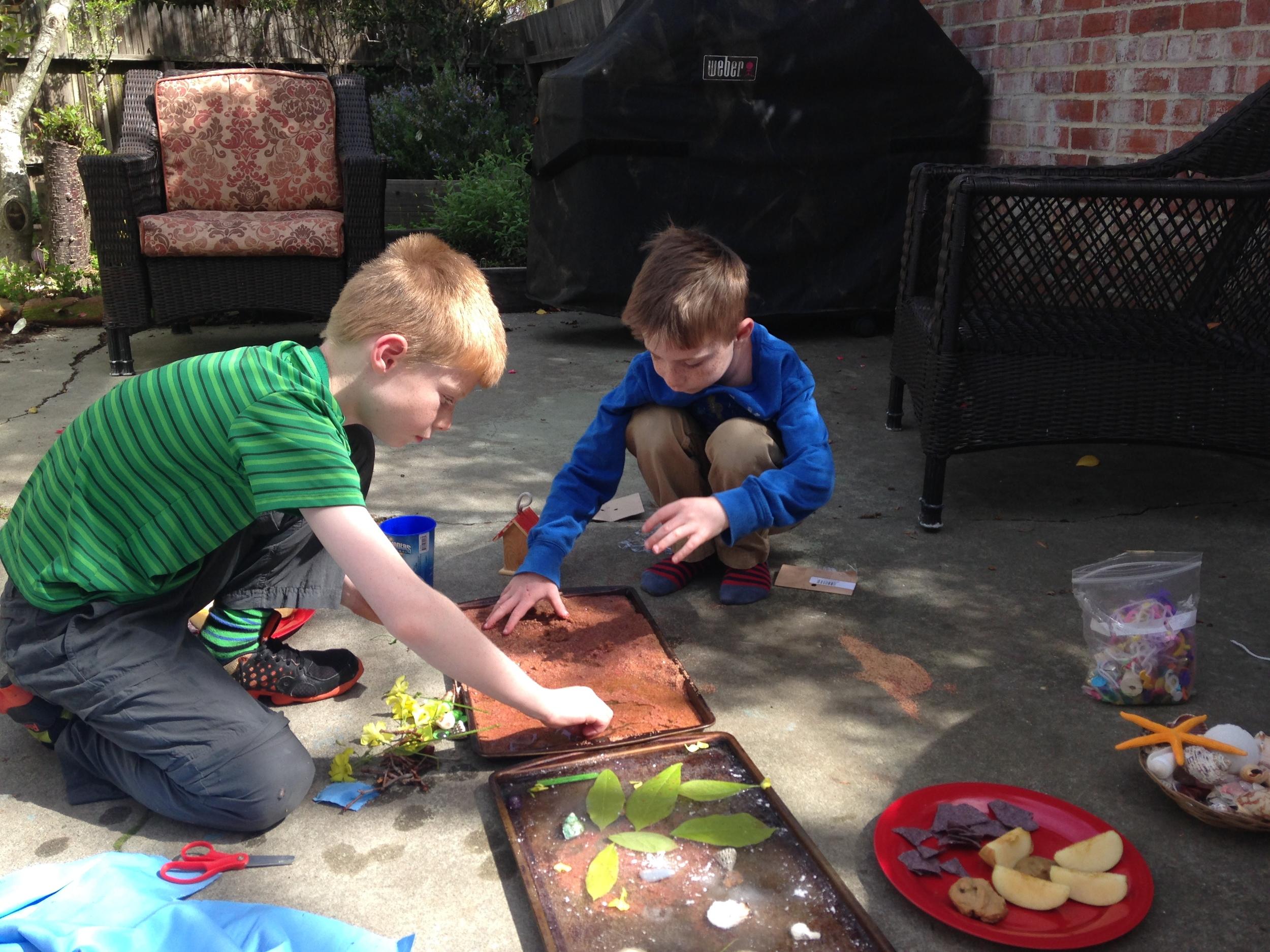 Dylan and Aidan busy building their beach.