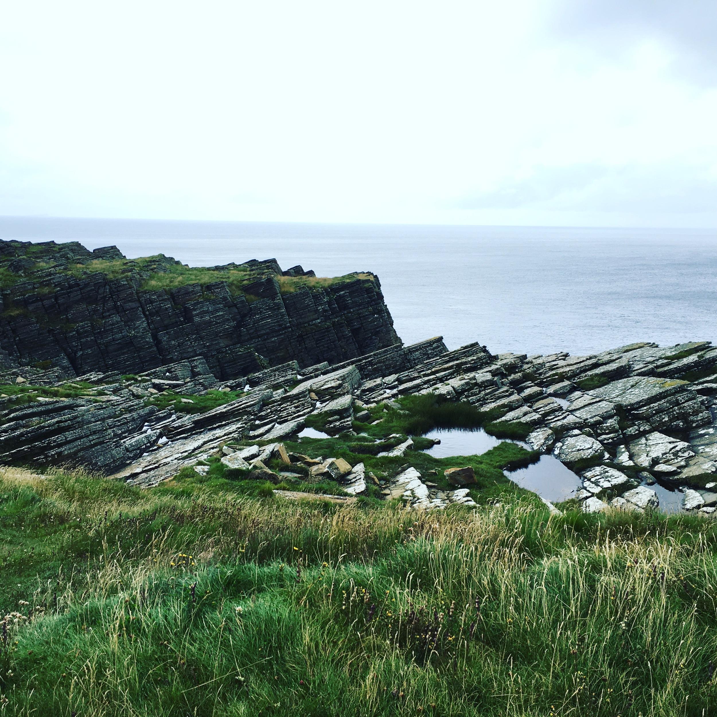 Majestic cliffs above the sea.