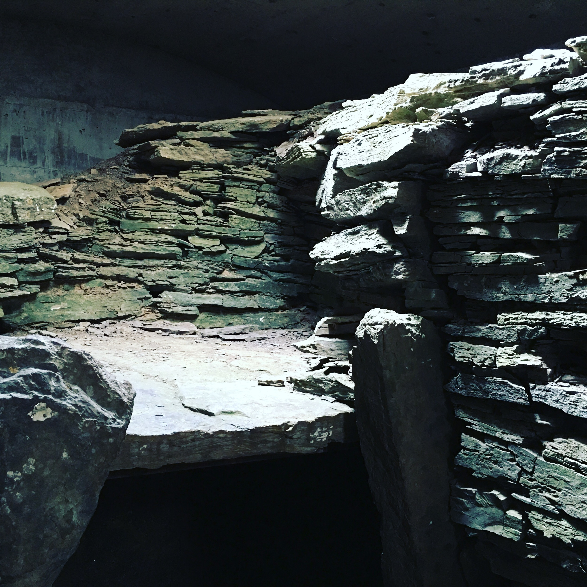 Inside the Neolithic burial cairn The Tomb of the Eagles.