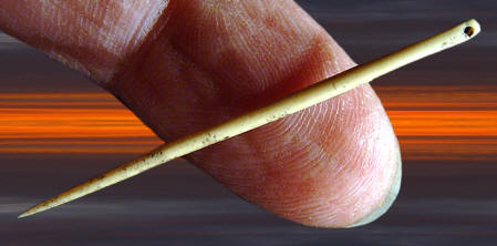 EST. 10,500 TO 11,000 YEARS BEFORE PRESENT COPYRIGHT AUGUST 31, 2012 PETER A. BOSTROM Cast of a bone needle from the Buhl site.