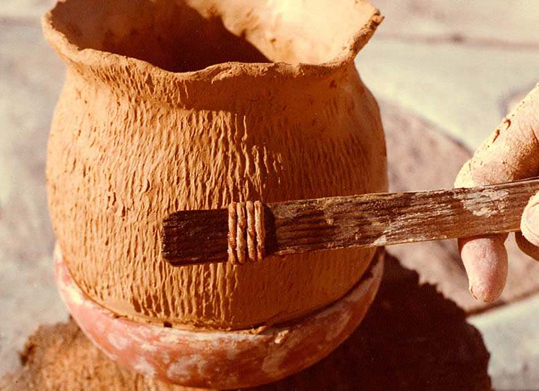 Making cord marked pottery with a paddle. From the Texas Beyond History website.