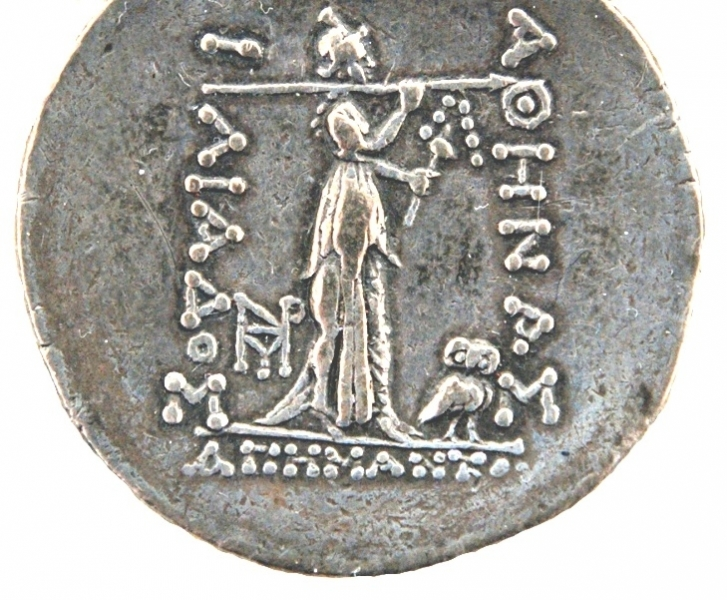 Reverse of a tetradrachm struck at Ilion, cult statue of Athena wearing a chiton with overfold and kalathos; in her left hand, a distaff or spindle, in her right hand a spear resting on her shoulder, 2nd c. BC.