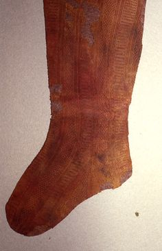 Red silk stocking buried with Eleanor de Toledo.