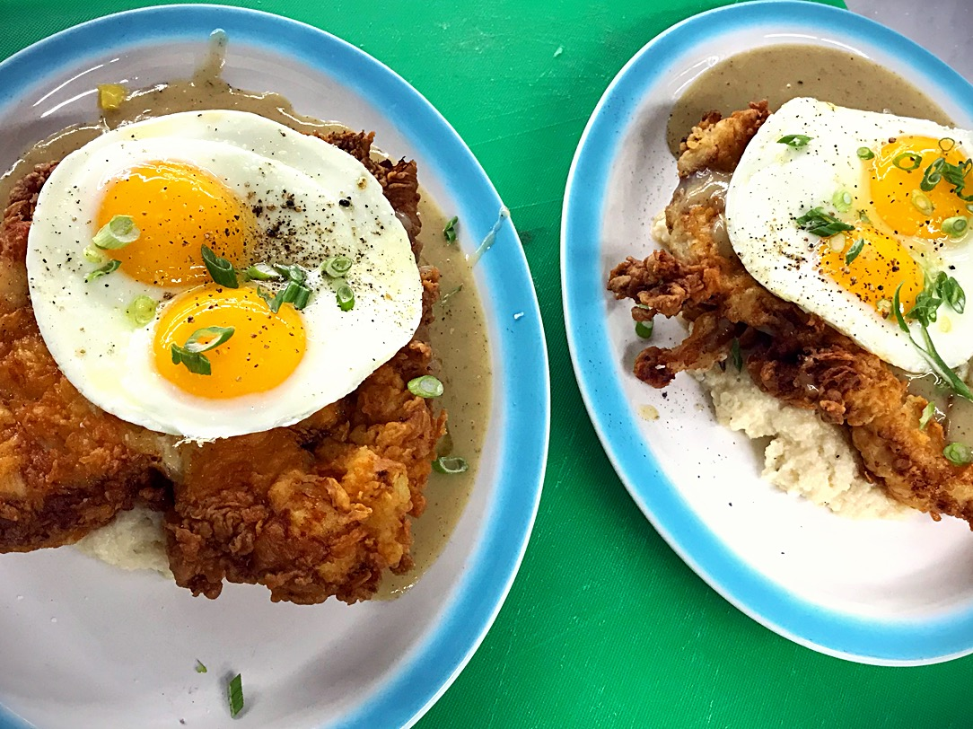 Mels Diner. Chicken fried chicken, cheesy Grits, and two eggs sunny side up.
