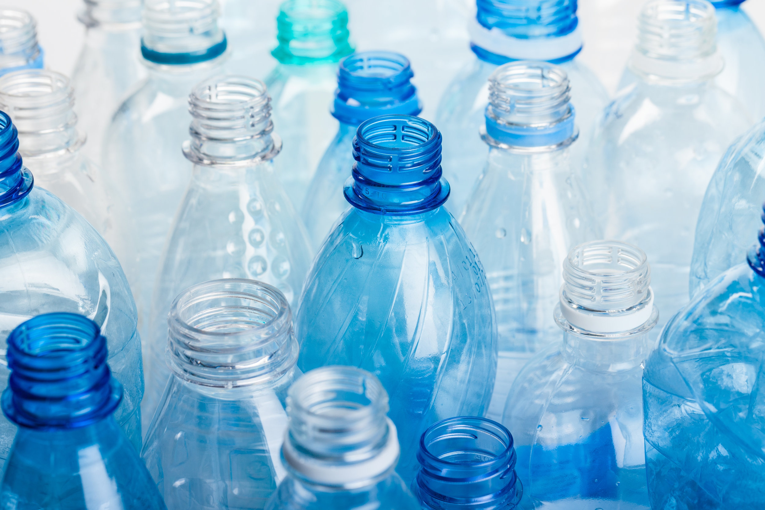 plastic bottles clear and blue-ts-585288480.jpg