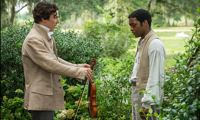 Benedict Cumberbatch as the kind slave owner Mr. Ford, with Chiwetel Ejiofor as Solomon Northrup