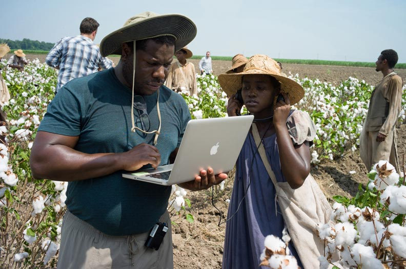 Director Steve McQueen with Academy Award winner Lupita N'yongo, who played slave girl Patsy