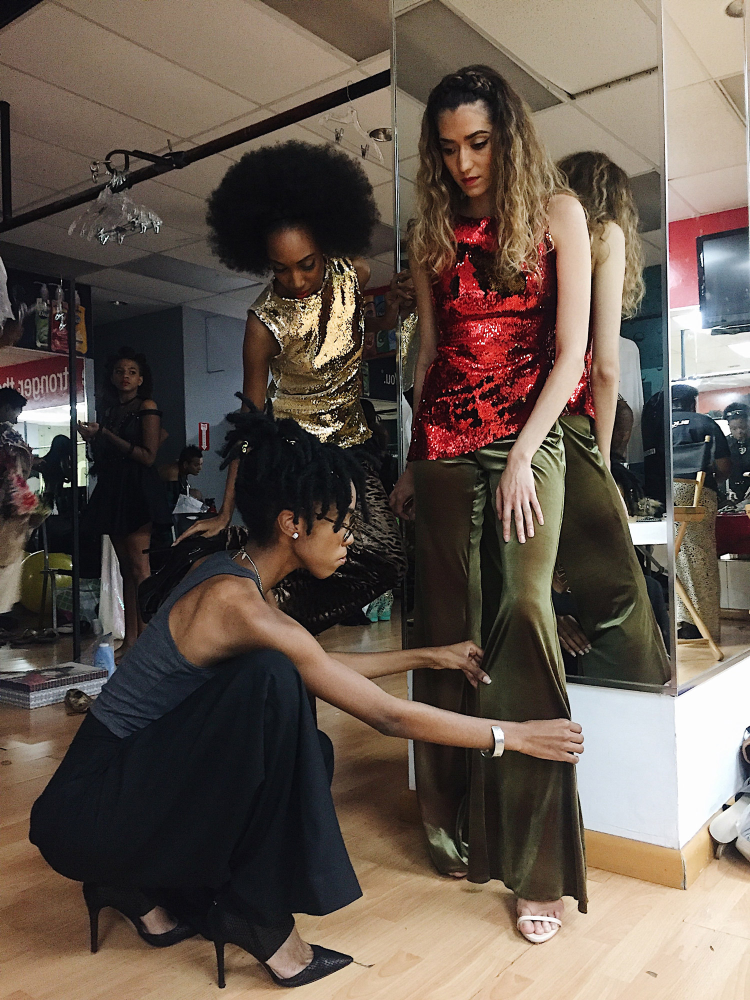 Backstage Claudia Pegus Runway Show. Photo by: Jayyidah Leonard.