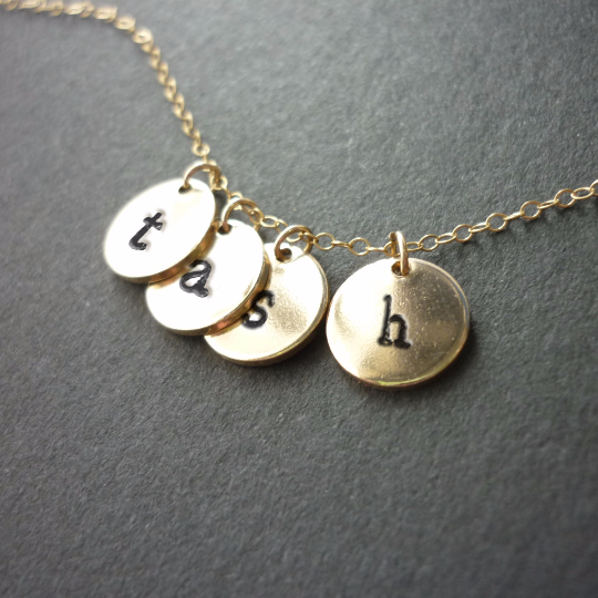 stamped necklace gold.png