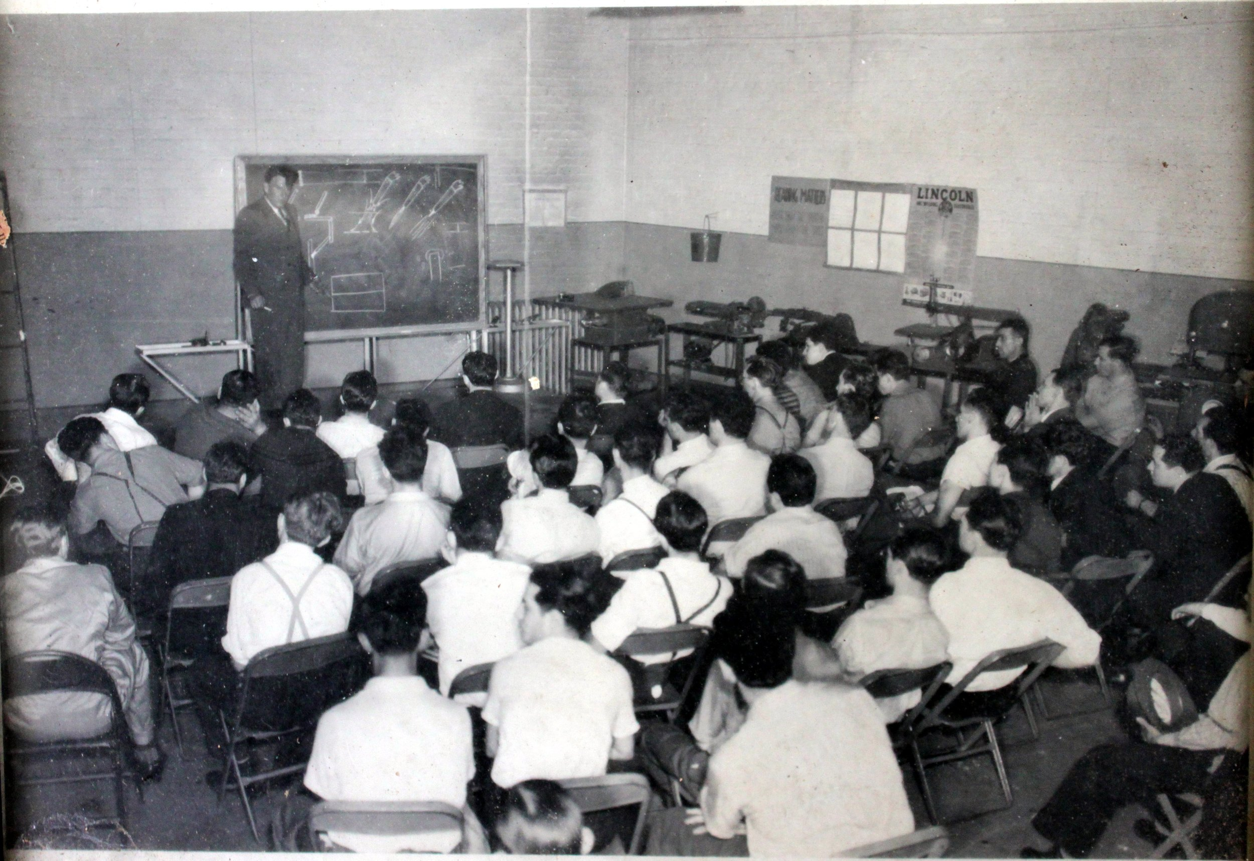 William Wicks lecturing to a class on the use of welding torches.