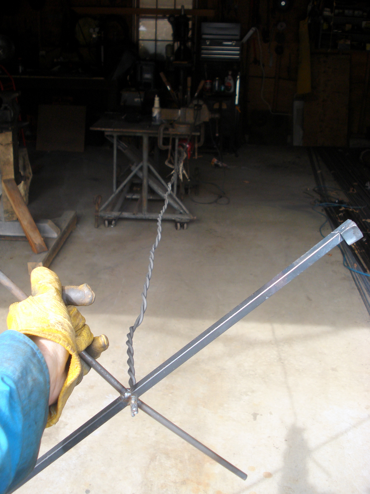 A jig used to create metal rope, two pieces of round bar were welded together at the ends and that X was used to wind them up.