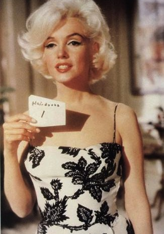 Marilyn doing a wardrobe check on the set of Something's Got to Give.