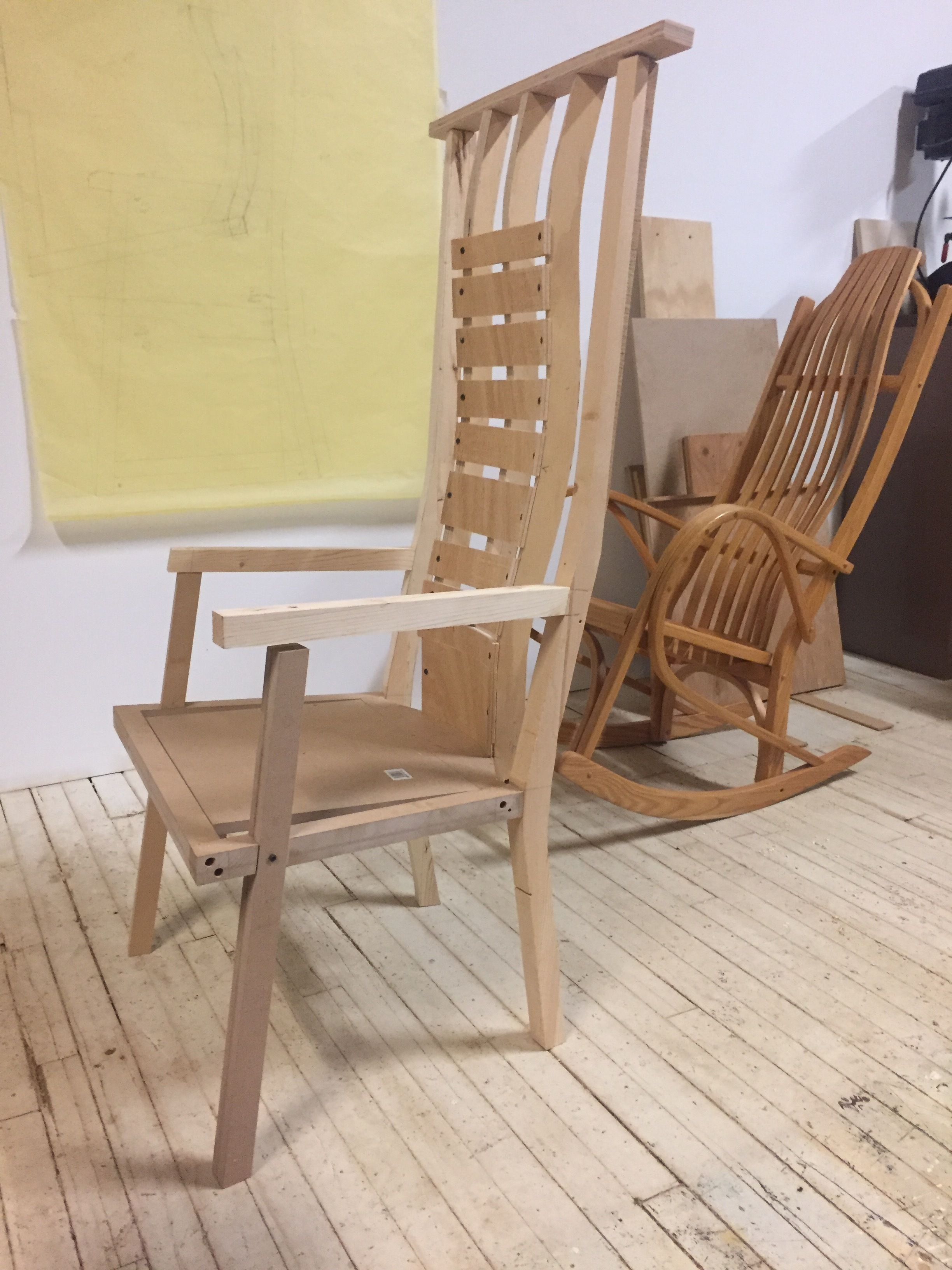 This is a mock up of the chair - inspired by the rocking chair behind it. (The horizontal boards on the back of the chair are temporary - for holding the curved vertical boards.)