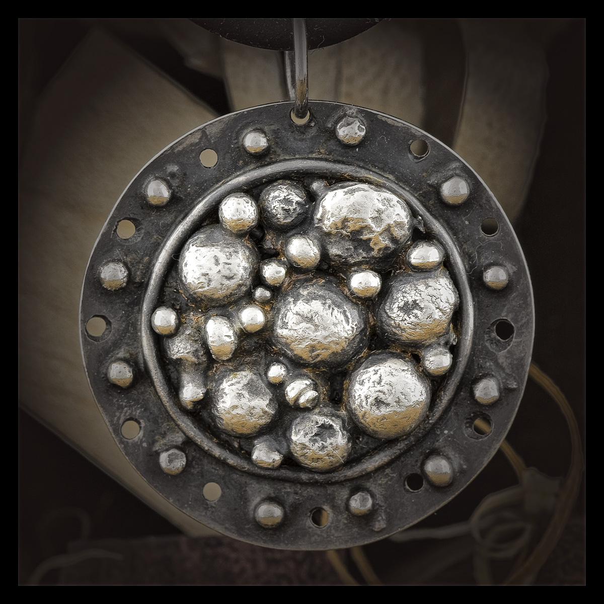 Scarlet's stepping stones medallion. Sterling silver with an antique patina.