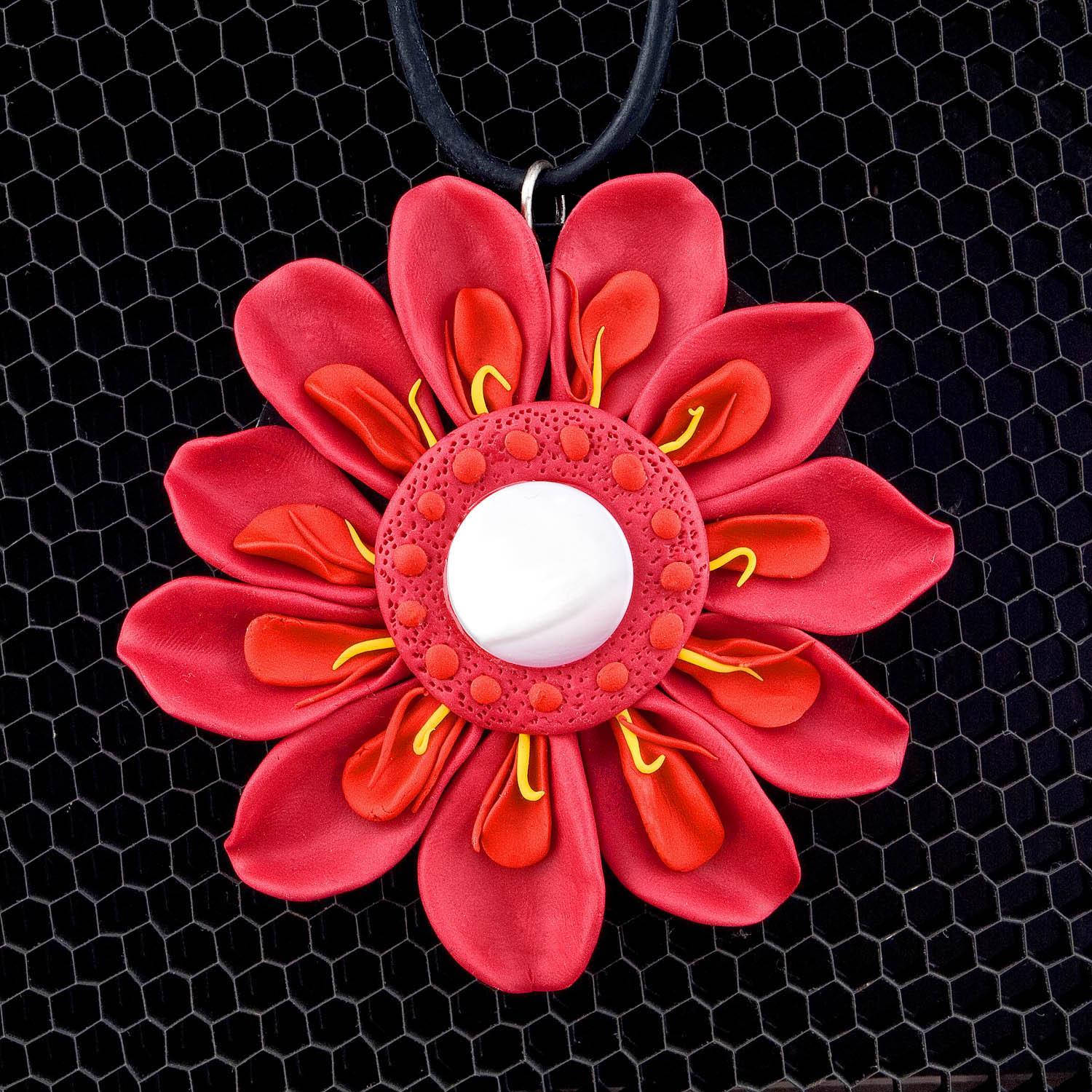 Scarlet's spring pendant - sterling silver, copper, polymer, mother-of-pearl. Thanks to Stephen Bennett for the awesome photo.