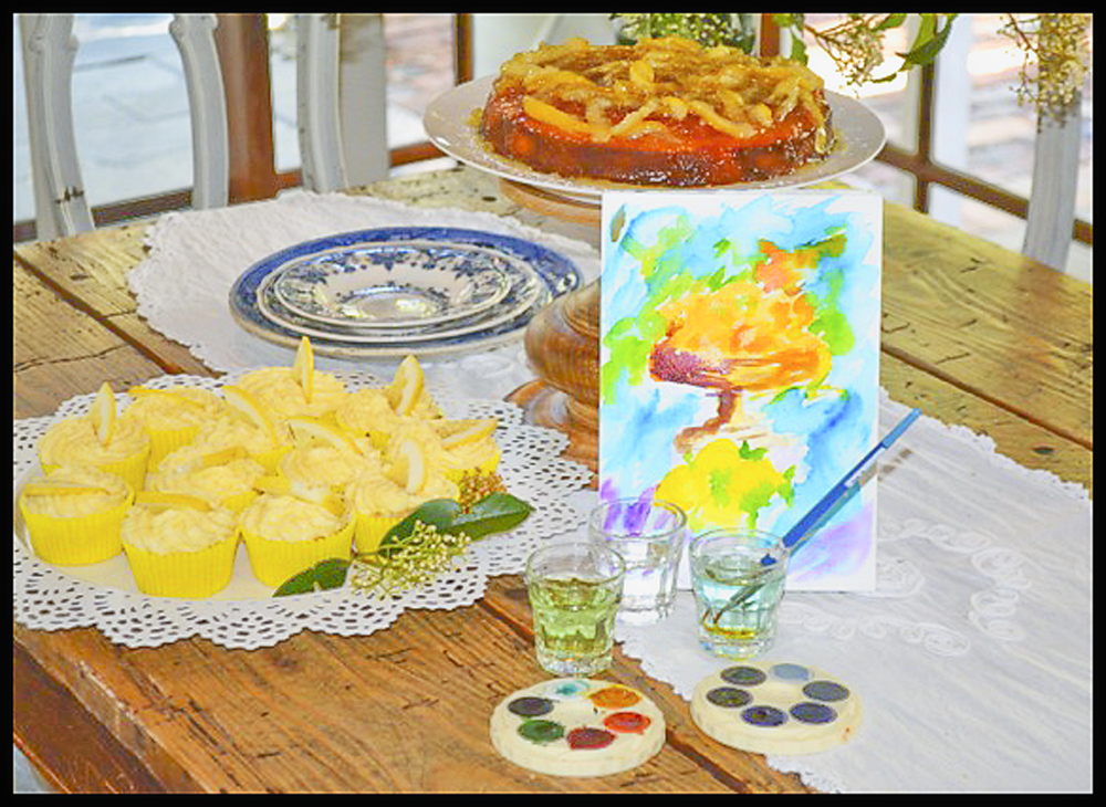 Keryn's candied lemon cake and lemon cupcakes, complete with watercolour still life