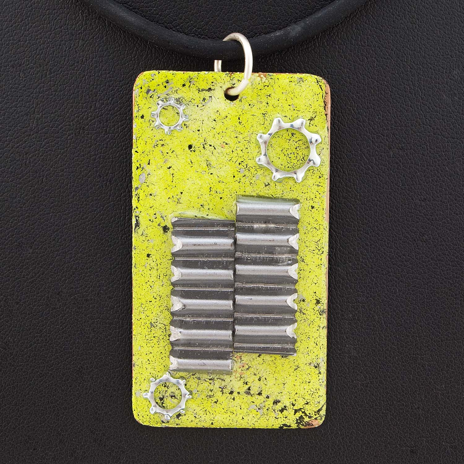This pendant was made with enameled copper, corrugated fasteners and star washers from the hardware store. Hannah took one look and said, 'Wow! That's quite cyber punk, Mum.' I knew that.