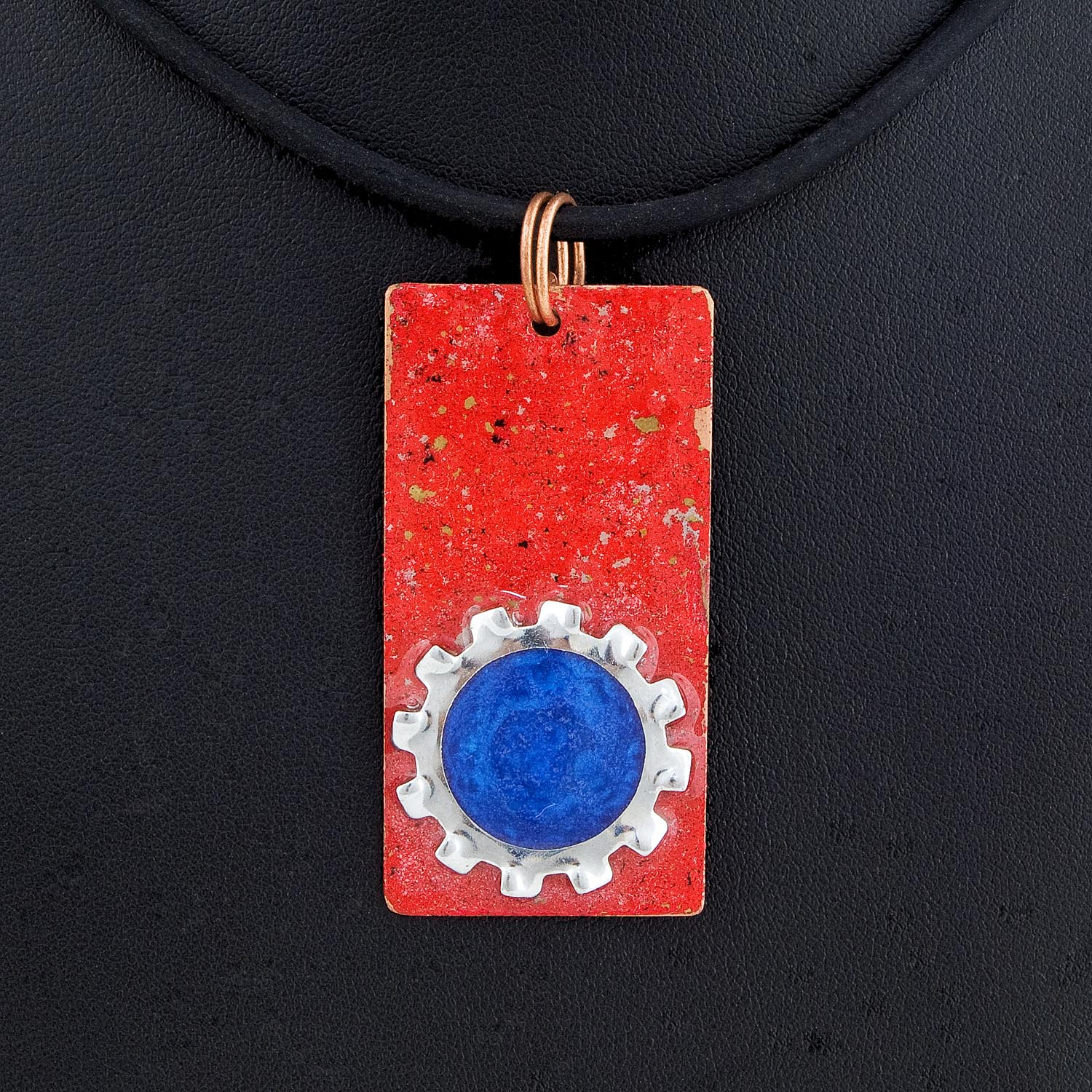 Enameled copper with a star washer bezel and blue mica dyed resin.