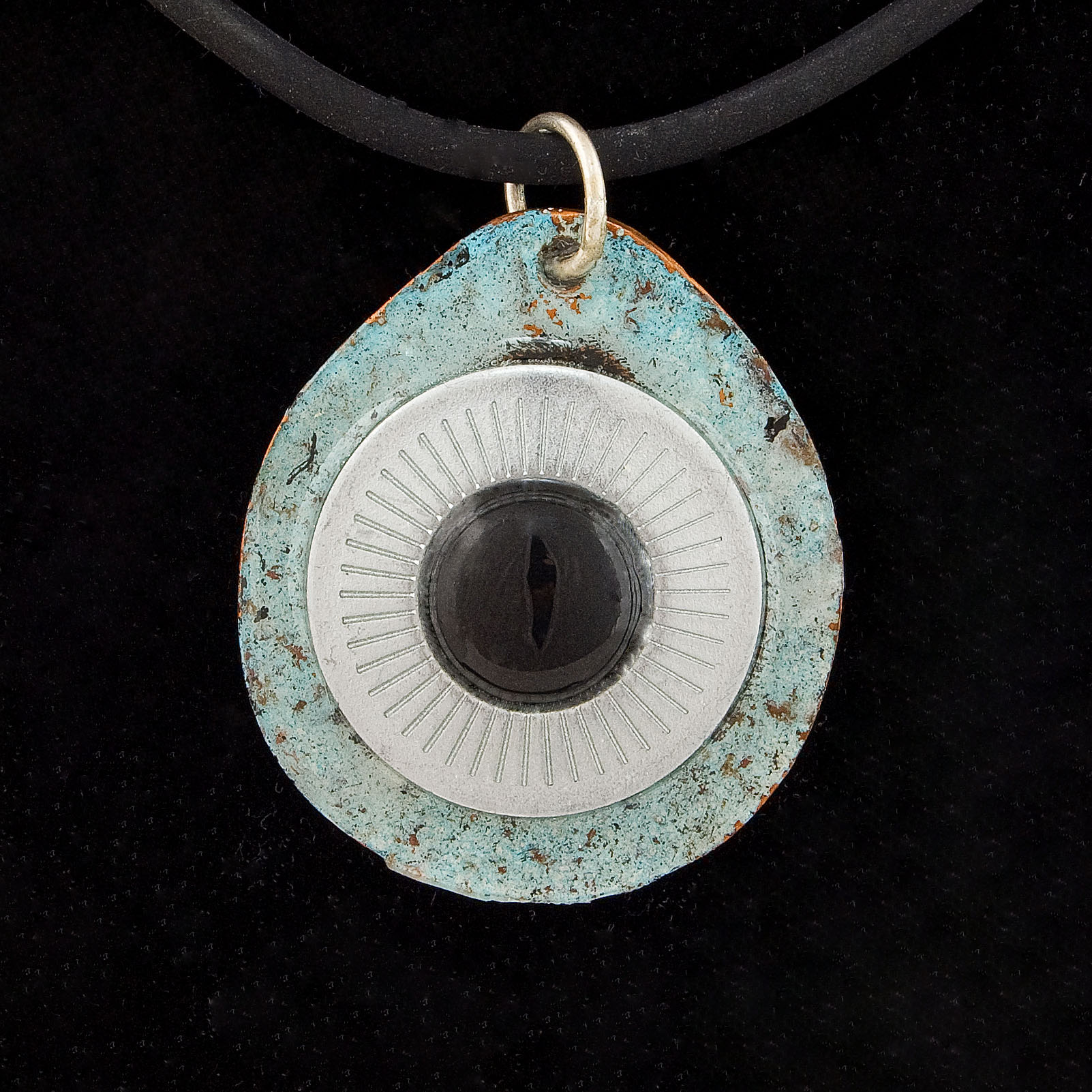Copper pendant base with turquoise enamel, a large metal washer, with a left-over screw cap from the black and white pendant fitted snugly into the centre.