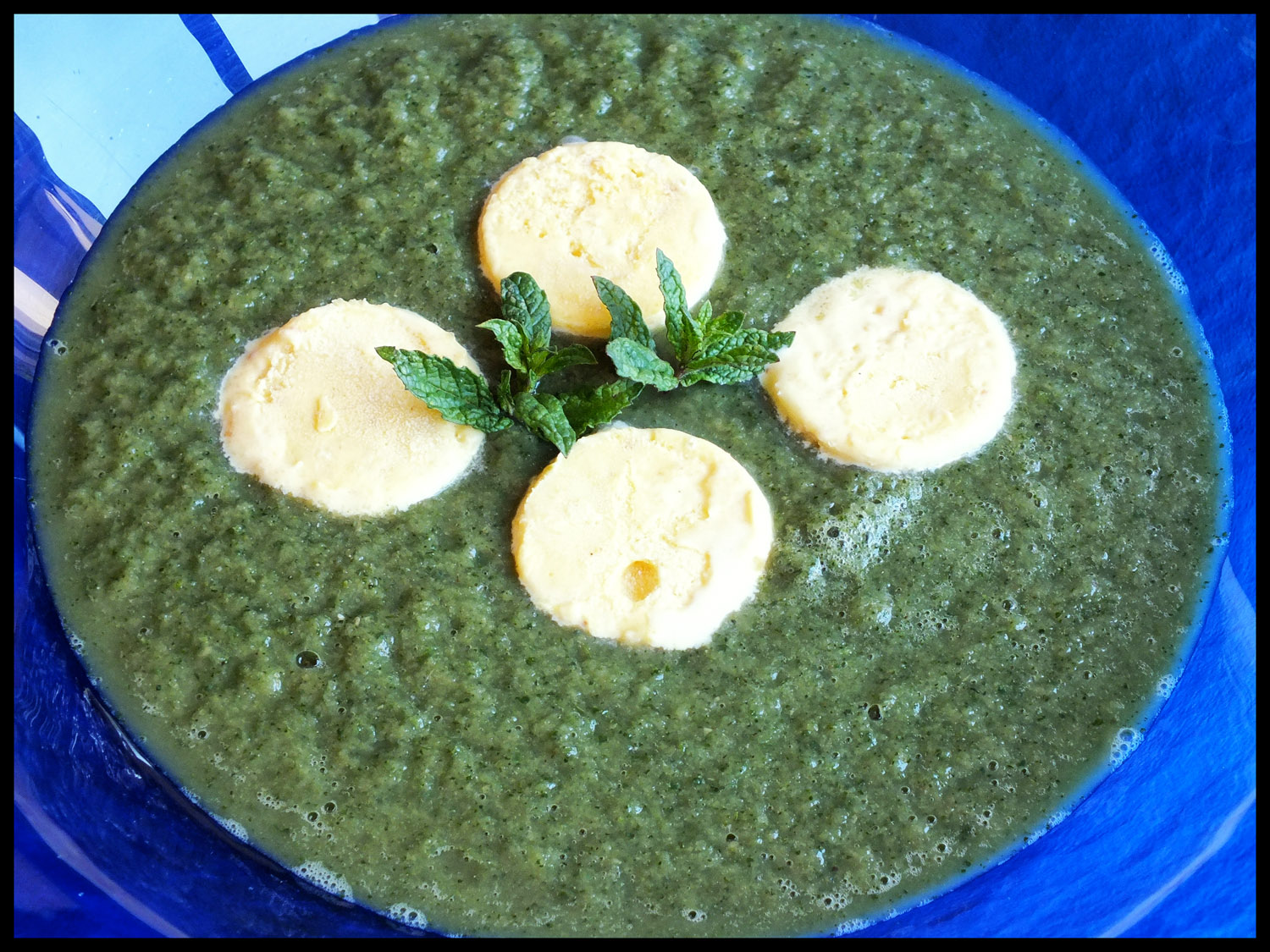 Raw green soup with parmesan ice cream