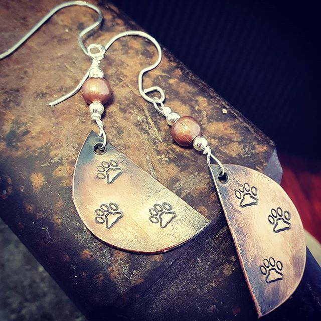 Paw prints to the heart. Hand forged copper. Warm and earthy.