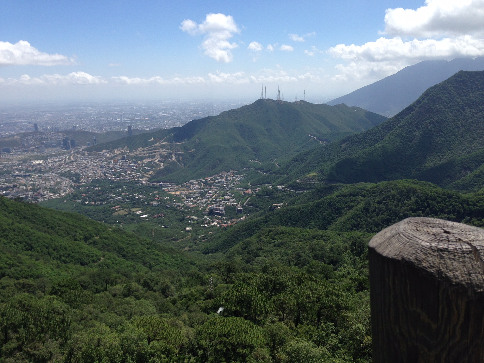 """View from Chipinque at Monterrey Mexico, looking toward Guadalupe's former steel plant the largest of its kind when built in 1968, """"Corruption Tower,"""" one of Monterrey's most beautiful new government buildings, and outside the photo, half a mountain mined for its concrete. A frightening sight."""