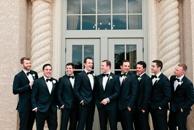Picture of groom and groomsmen in tuxedos on the wedding day.  They are standing in front of TPC at Sawgrass in Ponte Vedra, Florida.  This image shows the work of Debra Eby, Jacksonville Fine Art photographer