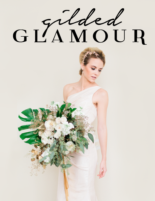 "Picture of a bride on a wedding day with a tropical inspired bridal bouquet.  The bride is standing against a cream colored wall and is looking down.  There is text at the top of the image that says, ""gilded glamour"".  This image is of an elegant bride with hair pulled back.  The wedding gown is one strap and straight.  This image showcases Debra Eby, Jacksonville fine art wedding photographer as an editorial photographer whose work is published on many media outlets."