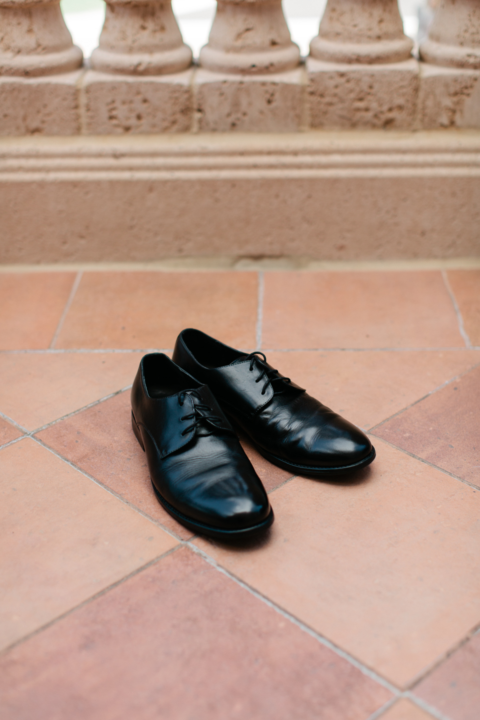 Image of men's dress shoes in black on terracotta tile at the TPC Sawgrass in Ponte Vedra, Florida