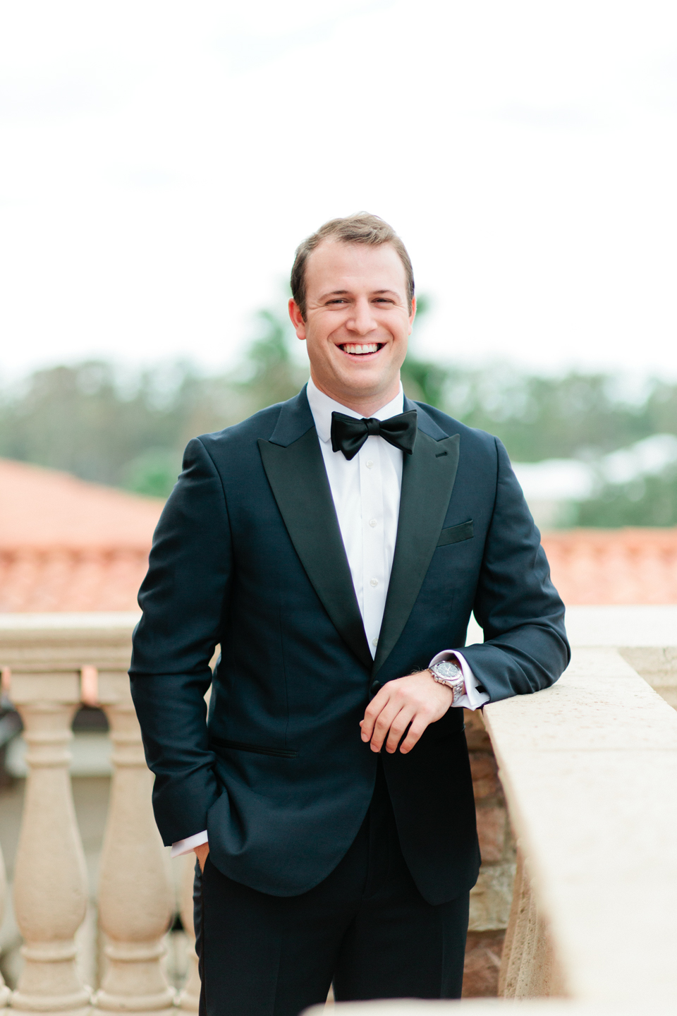 Image of a groom in a black tuxedo on the second floor of the TPC Sawgrass in Ponte Vedra, Florida