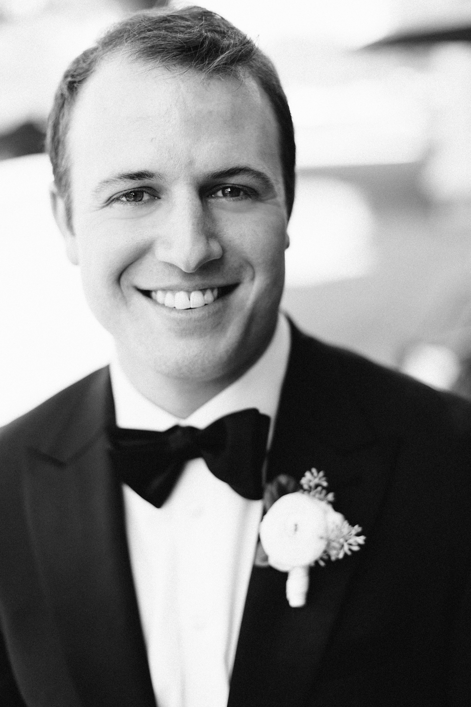 Image of a groom in a black tuxedo on this wedding day.  The groom is at the TPC Sawgrass in Ponte Vedra, Florida