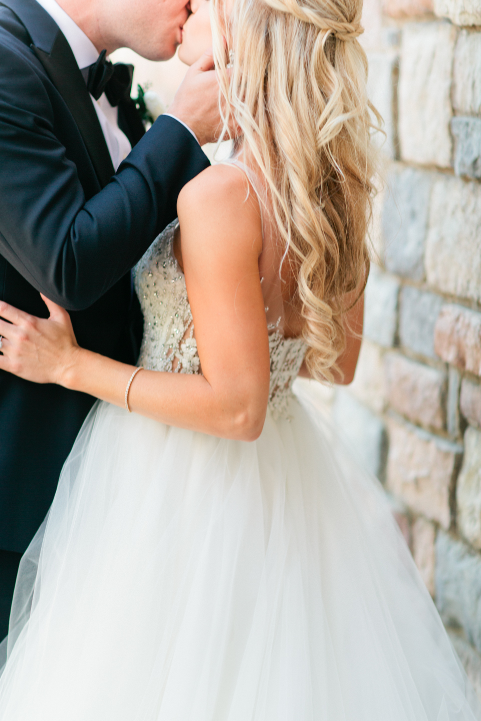 Image of a groom kissing his bride on their wedding day at TPC Sawgrass in Ponte Vedra, Florida
