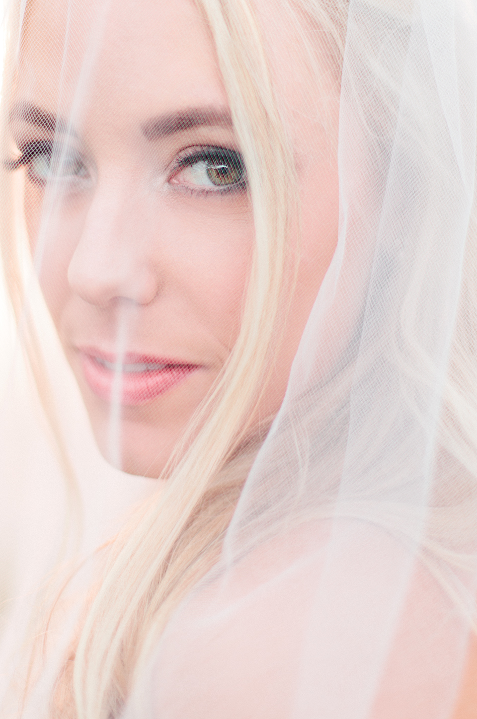 Picture of a bride under her veil on her wedding day at TPC Sawgrass in Ponte Vedra, Florida