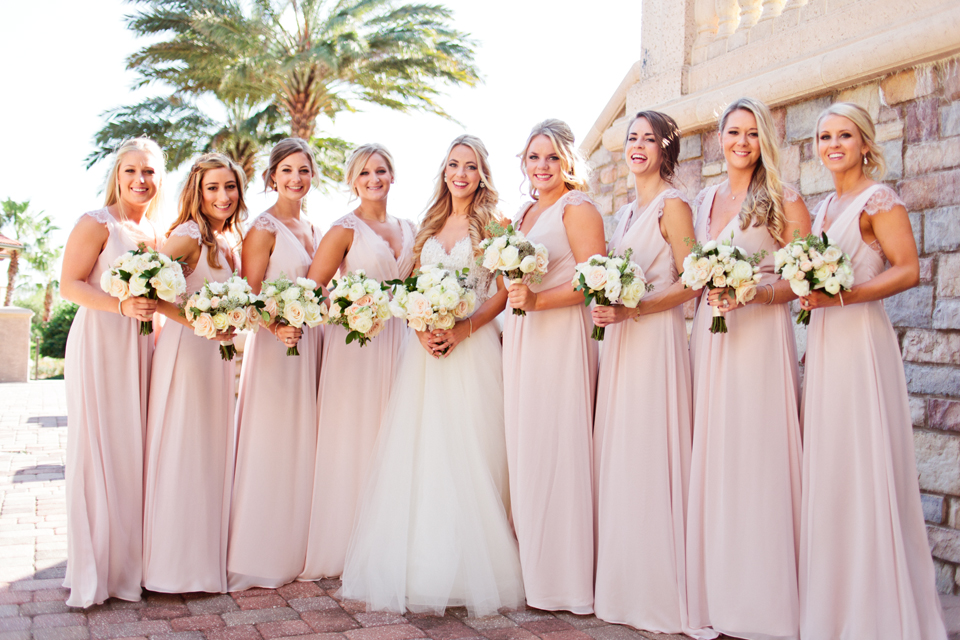 Picture of a bride and her bridesmaids with their bouquets.  The wedding is at TPC Sawgrass in Ponte Vedra, Florida